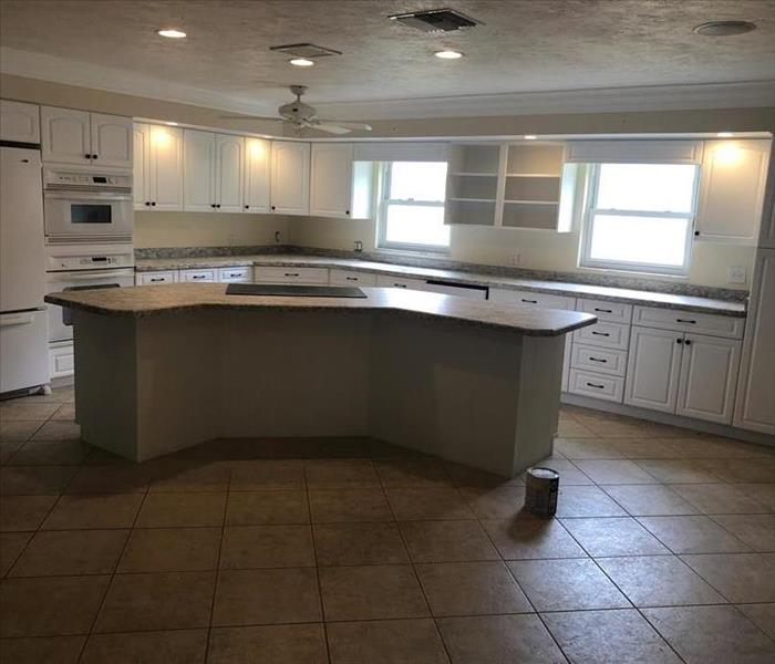Fully restored kitchen with new cabinets and counter tops in place