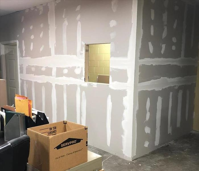 bare sheet rock walls with mud and tape