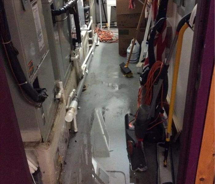 Standing water on the floor of an electrical room