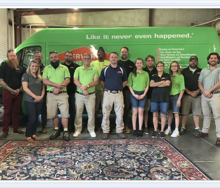 Our crew standing in front of our green van